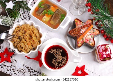 red borscht,sauerkraut with mushrooms,carp in jelly, and dried fruit cake for traditional polish christmas eve supper