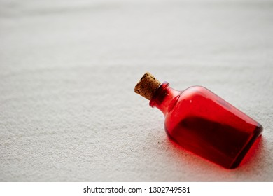 Red bottle with sand