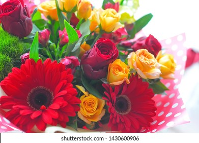 red bouquet of flowers on a white background