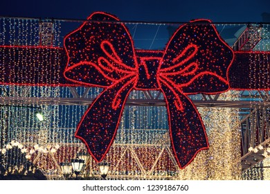 Red bow and Christmas city lights at night Kiev