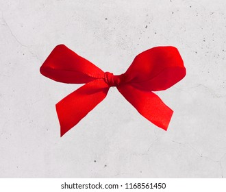 red bow on concrete background
