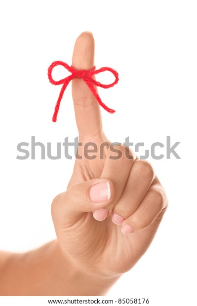 Red bow on woman finger isolated on white background