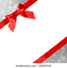 Red Bow and Ribbon with Silver Abstract Lights and White Background