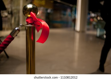red bow at the store opening. solemn cutting of a red ribbon. Solemn opening ceremony of a new shopping center