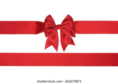 Red bow and two slanting ribbons isolated on white.