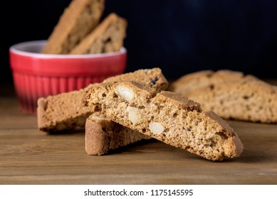 Red Bowl with Fresh Baked Biscotti Cantucci Italian Almond Sweets Biscuits Cookies Wooden Background Copy Space