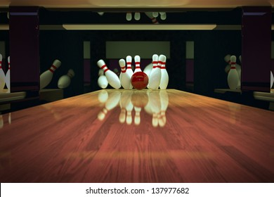 Red bowling ball is making a strike on wooden lane.