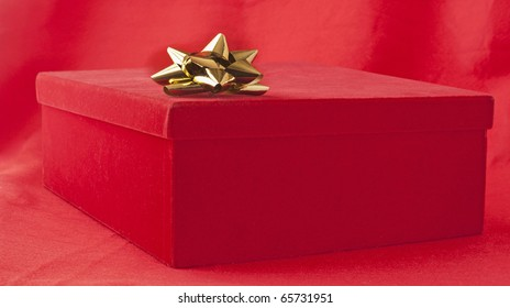 Red box containing a gift over red background