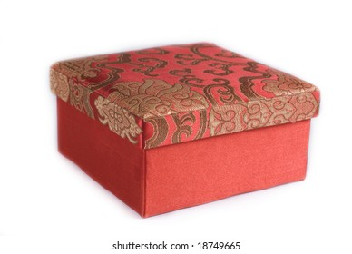 Red box isolated on a white background. The box is engraved with golden threads.