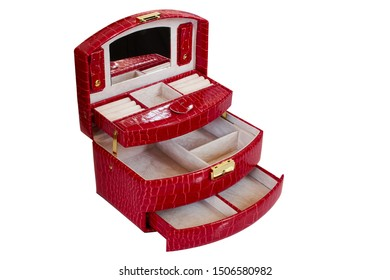 Red box for women's jewelry made of artificial leather. Casket with lots of compartments. Isolated, white background.