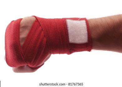 red boxing bandage on hand isolated white background