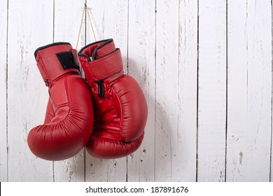 red boxing gloves hanging on the wall