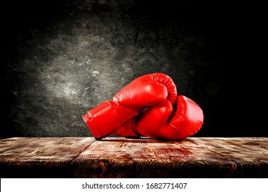Red boxing gloves on table and free space for your decoration.