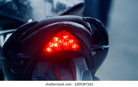 Red brake lights of a modern motorbike unique photo