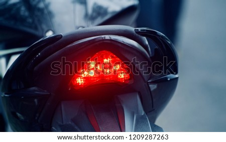 Red brake lights of a modern motorbike unique photo
