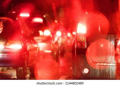 Red brake lights in traffic jam in rain