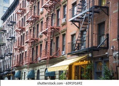 Red brick apartment building with fire escape in New York city