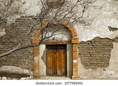 Red Brick Arch over a Wooden Door at an old mission in the southwest