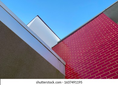 a red brick building with angle roof line