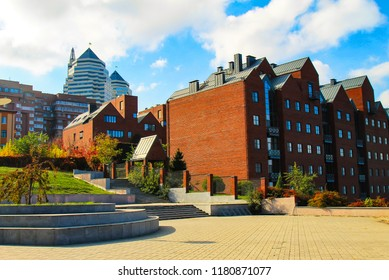 Red brick building and skyscrapers in  Dnepropetrovsk city in autumn, Dnipro, Dnipropetrovsk, Dnepr, Ukraine