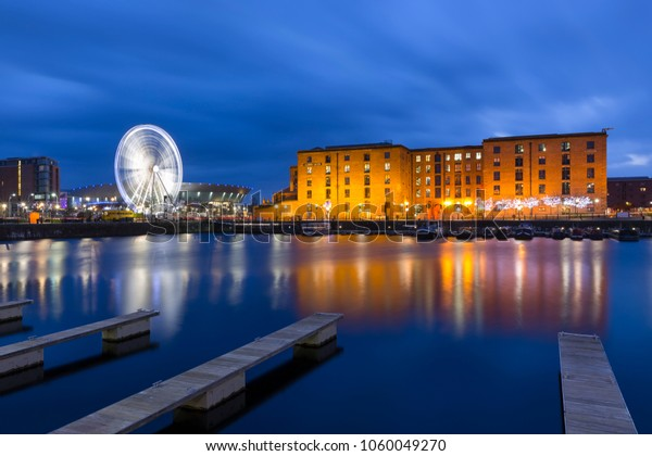 Red brick buildings of the Albert Dock, The Wheel of Liverpool and Liverpool Arena viewed from Salthouse Dock at Night