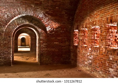 Red brick casemate gallery with shooting windows in a bastion of 19th century fortress. Daugavpils, Latvia.