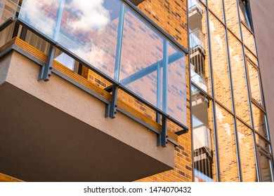 Red brick facade in modern architecture. Architectural detail of a modern apartament building.