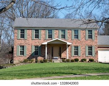 Red Brick Federal Style House with Teal Shutters