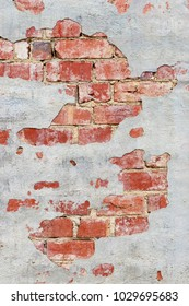 a red brick and flaking mortar wall background
