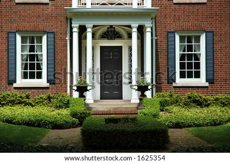 Red Brick House Black Shutters Green Stock Photo Edit Now 1625354