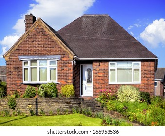 Red brick house with garden