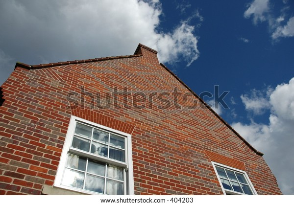 red brick house with sky as backdrop