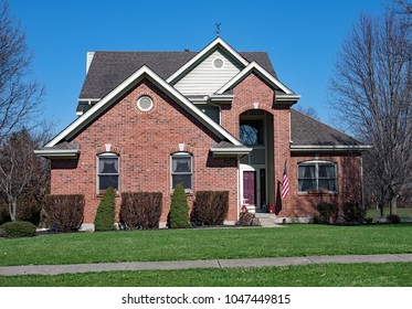 Red Brick House with Tall Entrance