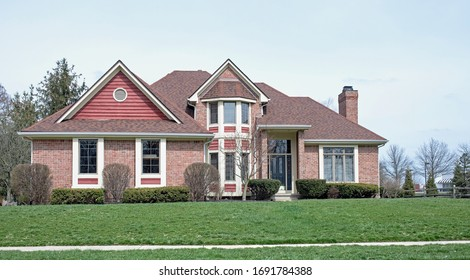 Red Brick House with Two Story Bay Window