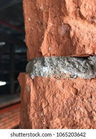 Red brick layer with concrete simen was hacking at the wall closed up