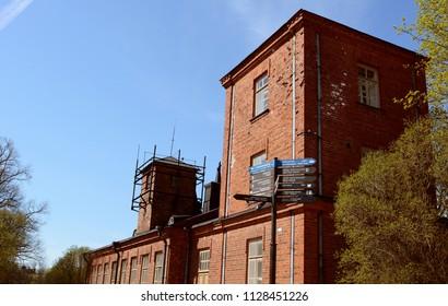 Red brick military building on Suomenlinna fortress island near Helsinki, Finland