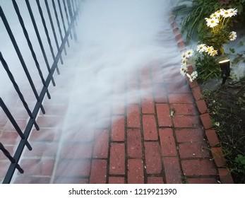 red brick sidewalk or path with smoke or fog