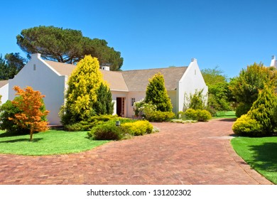 Red brick square in front of white house. Shot near Kuilsriver/Cape town, Western Cape, South Africa.