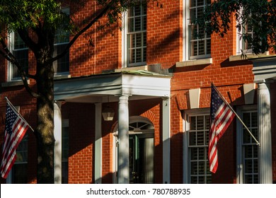 Red Brick Townhouses with White Columns and American Flags, Norfolk, Virginia, USA
