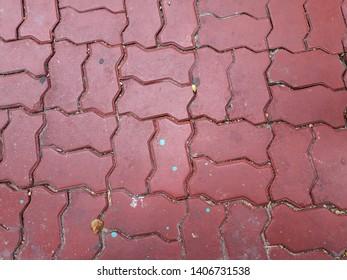 Red Brick Walkway.Brick walkway. Closeup superior view of lightly shaded red brick walkway pattern.