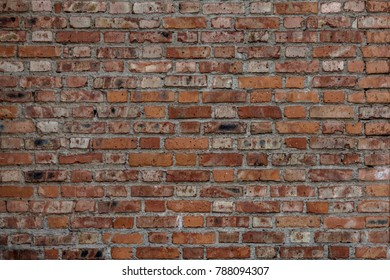 Red brick wall. Aged brick wall. Brick old background. Textured material. Architectural brickwork.