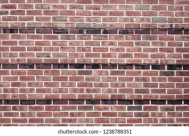 Red brick wall background texture close up