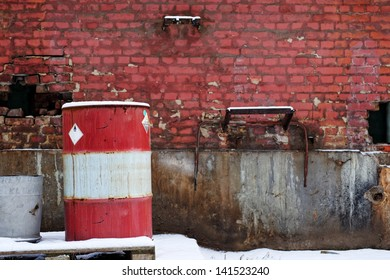 Red brick wall with barrel outdoors