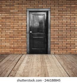 Red brick wall, black door and wooden floor, abstract empty interior background