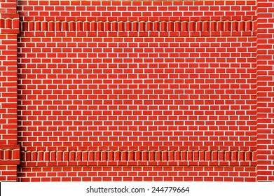 Red brick wall with brick decorative frame
