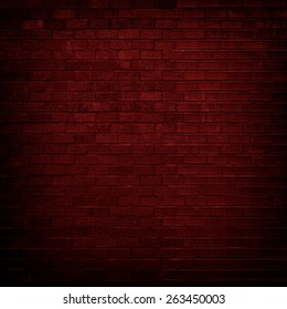 Red brick wall with dim light for background