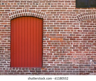 Red Brick Wall with a Red Door and Window