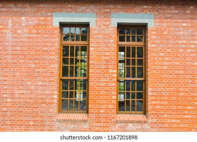 red brick wall with brick filled window, window on brick wall.