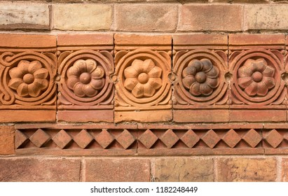 Red Brick Wall with flowers decorations and tiles