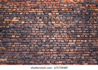 red brick wall, grunge weathered surface as background